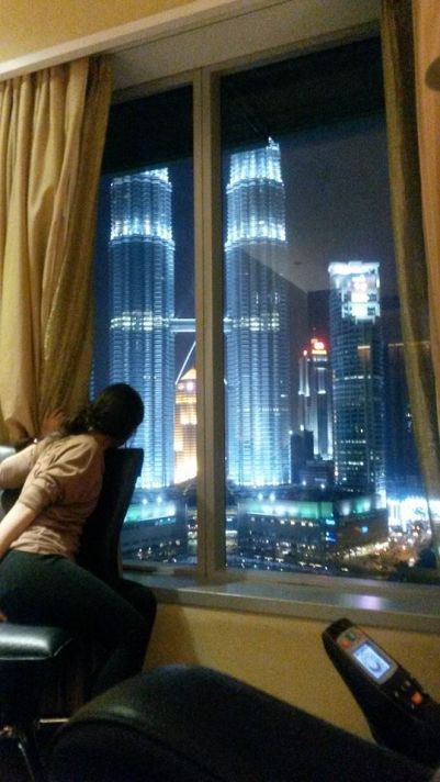 Chiemi looking out of the window at The Petronas Towers